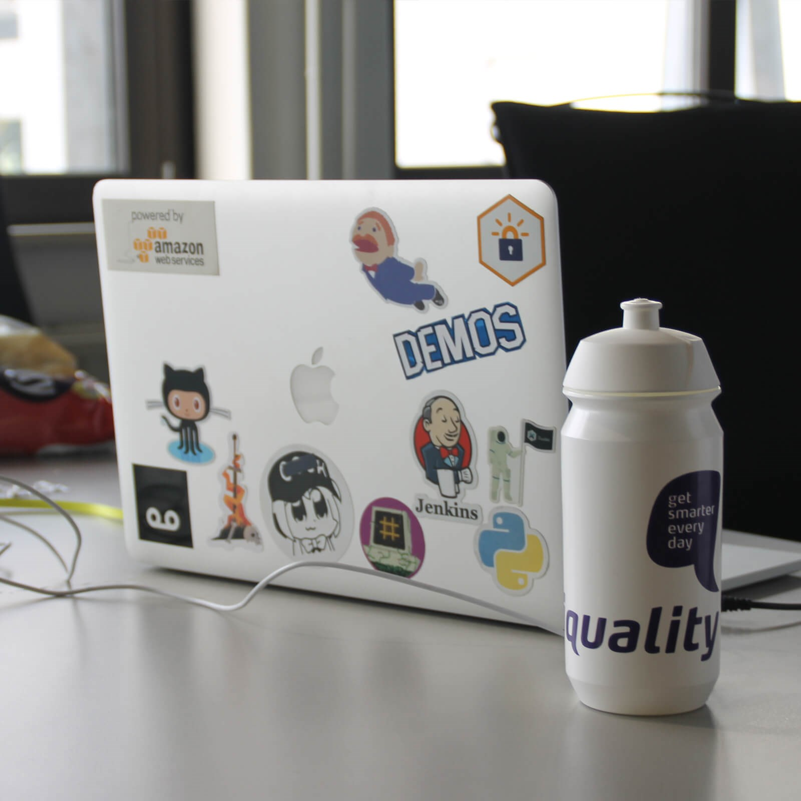 Laptop and Iquality bottle